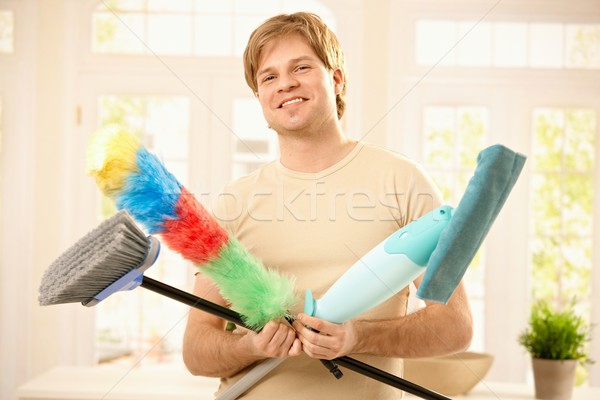 Confident guy with cleaning tools Stock photo © nyul