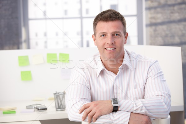 Casual office worker smiling in office Stock photo © nyul
