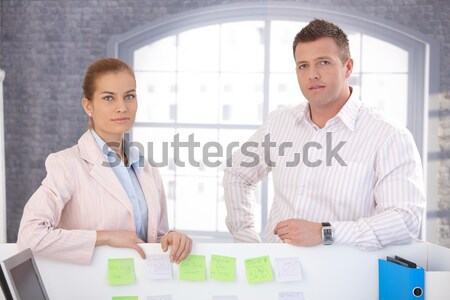 случайный служащих Постоянный за столе Сток-фото © nyul