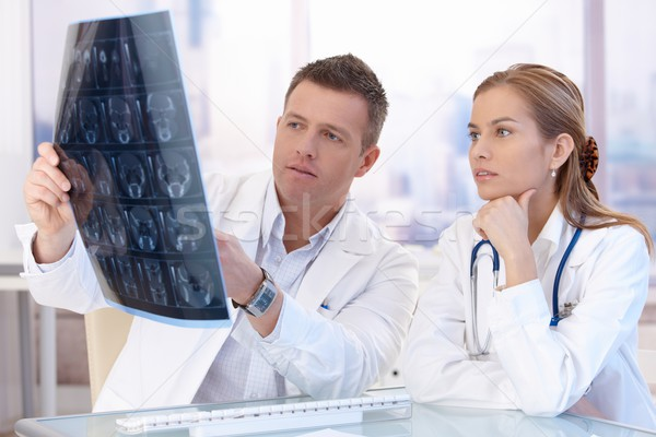 Two doctors studying x-ray image consulting Stock photo © nyul