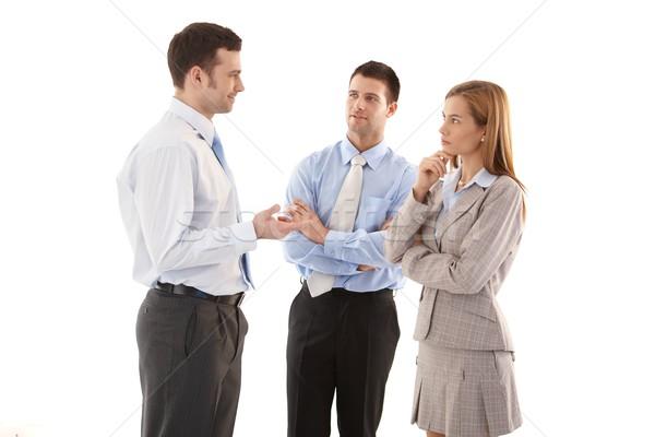 Fiatal üzletemberek beszél áll fehér mosolyog Stock fotó © nyul