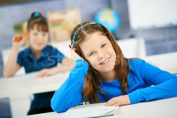 Nevet iskolás lány osztály ül dől kéz Stock fotó © nyul