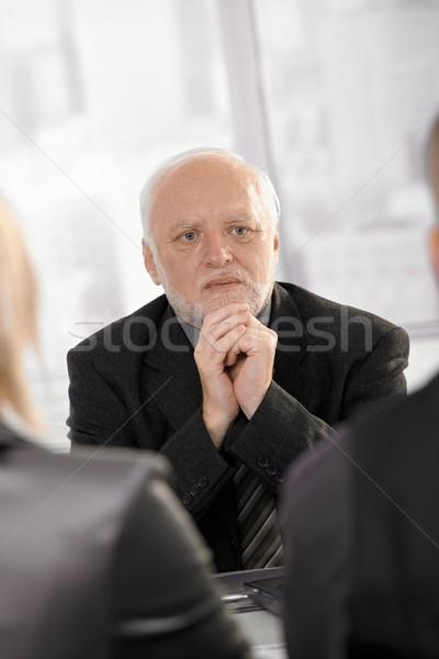 Competente imprenditore senior guardando grave riunione Foto d'archivio © nyul