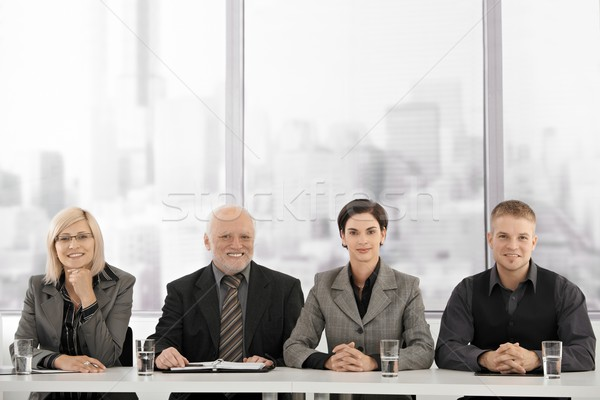 бизнес-команды заседание сидят таблице глядя камеры Сток-фото © nyul