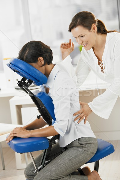 Businesswoman enjoying massage in office Stock photo © nyul