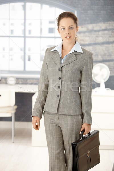 Attractive businesswoman arriving to bright office Stock photo © nyul