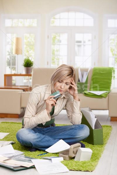 Problémás nő hitelkártya ül padló lábak Stock fotó © nyul