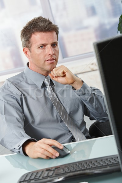Businessman focusing on task Stock photo © nyul