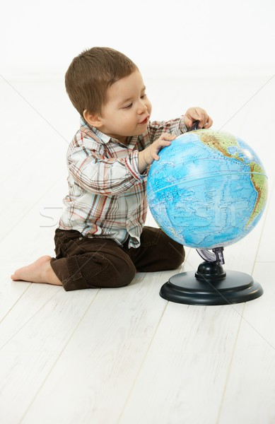 Little boy playing with globe Stock photo © nyul
