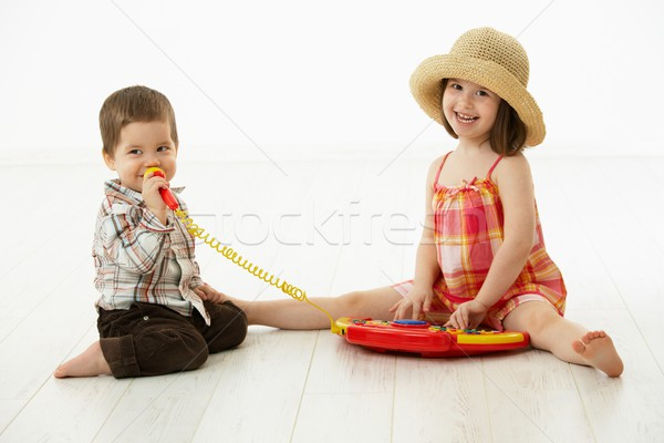 Little children playing with toy instrument Stock photo © nyul