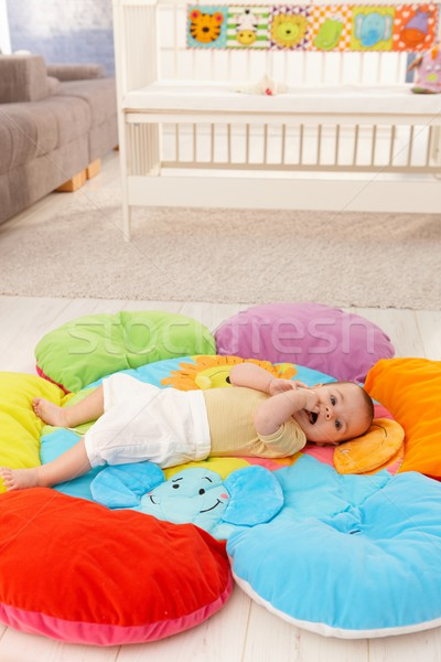 Baby on flowery playmat Stock photo © nyul