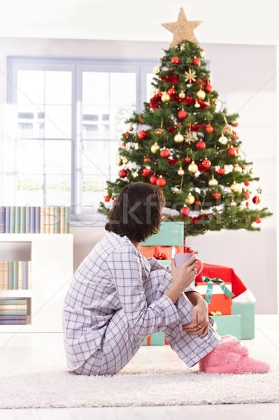 Woman in pyjama on christmas morning Stock photo © nyul