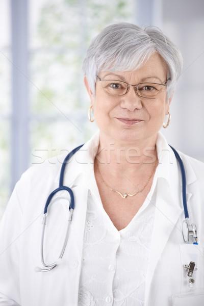 Retrato amavelmente sorridente feminino senior médico Foto stock © nyul