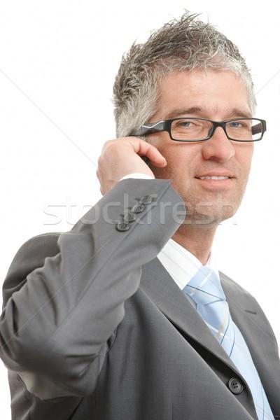 Businessman talking on mobile Stock photo © nyul