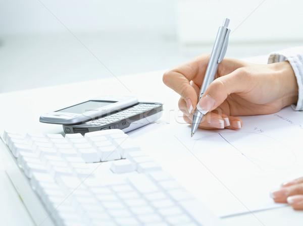 Female hand writing on paper Stock photo © nyul