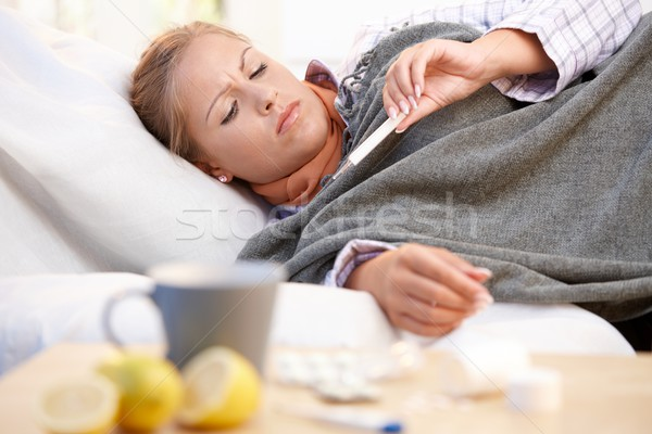 Young female having flu laying in bed Stock photo © nyul
