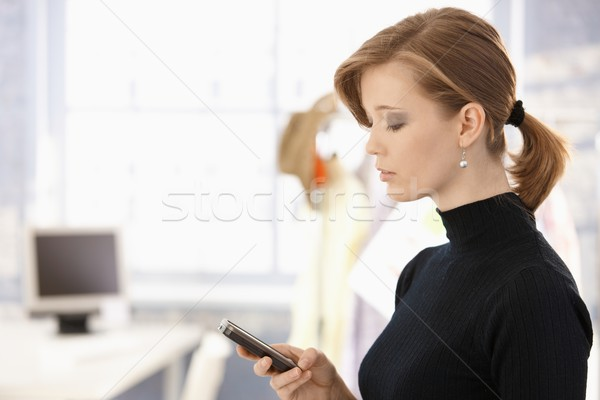 Attractive woman using mobile Stock photo © nyul