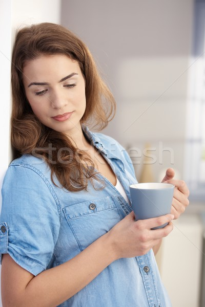 Daydreaming woman drinking tea at home Stock photo © nyul