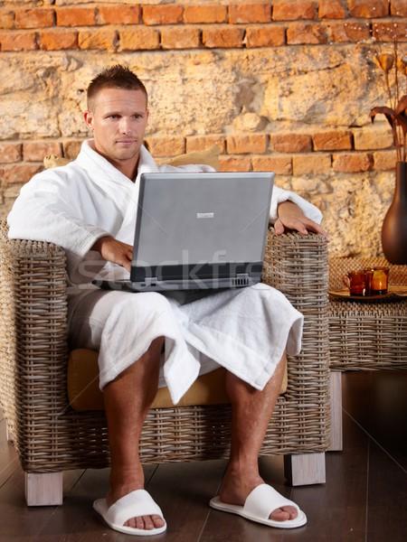 バスローブ 男 ノートパソコン 肖像 着用 ラップトップを使用して ストックフォト © nyul