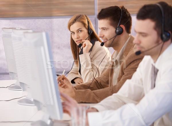 Attractive female customer servicer working Stock photo © nyul