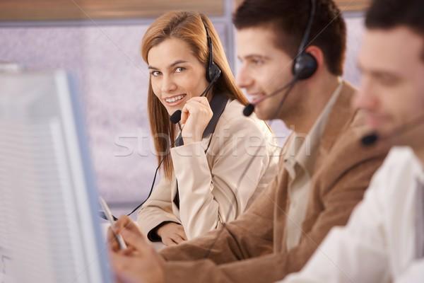Pretty female dispatcher in call center smiling Stock photo © nyul