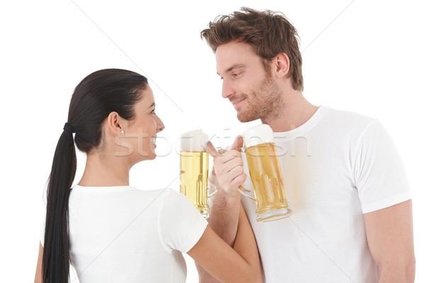 Young couple drinking beer smiling Stock photo © nyul
