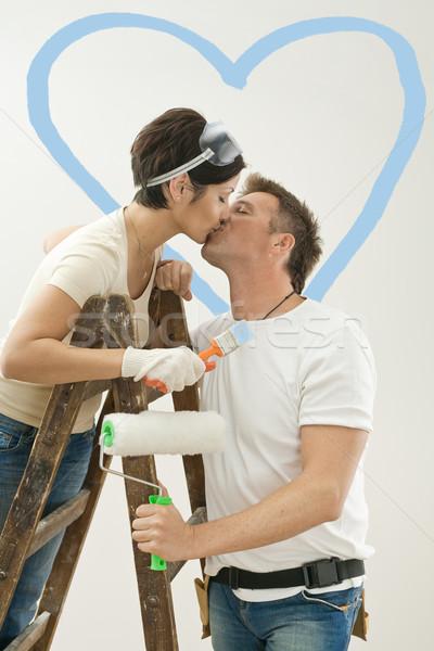 Szeretet pár csók új otthon fiatal pér festmény Stock fotó © nyul