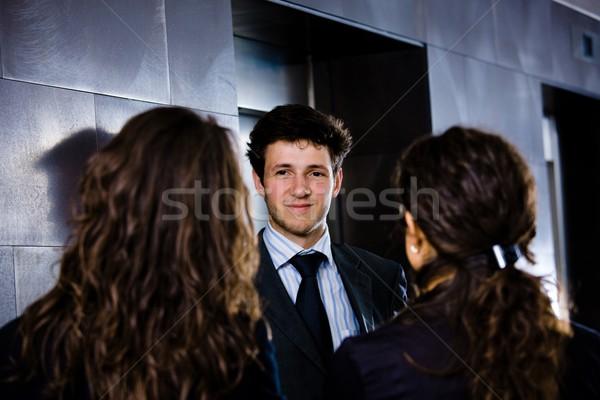 Uomini d'affari parlando felice giovani imprenditore Foto d'archivio © nyul