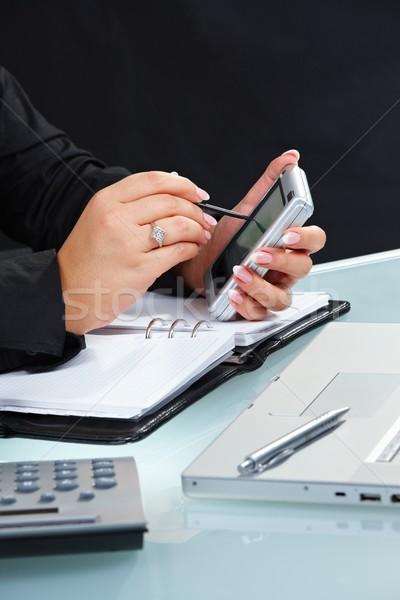 Female hand using handheld Stock photo © nyul