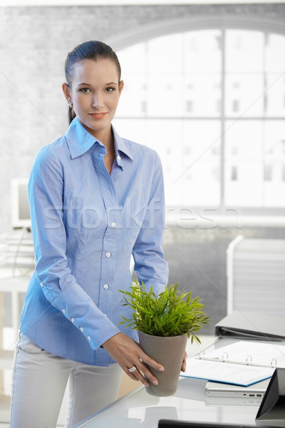Young businesswoman holding potted plant Stock photo © nyul