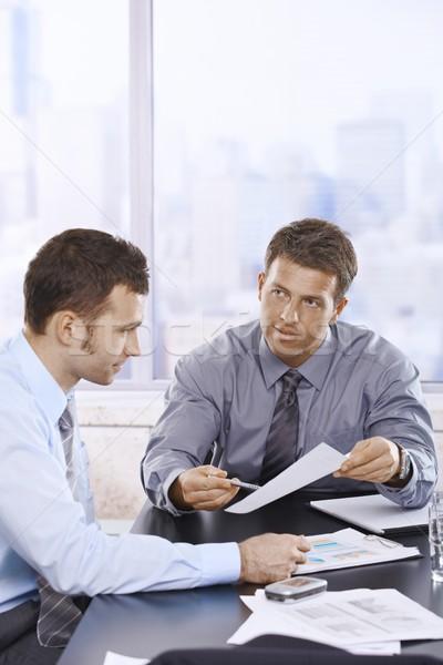 Businessmen discussing report Stock photo © nyul