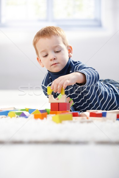 Lovely 3 year old playing with cubes at home Stock photo © nyul