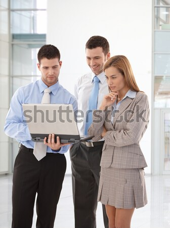 Young businesspeople browsing internet smiling Stock photo © nyul