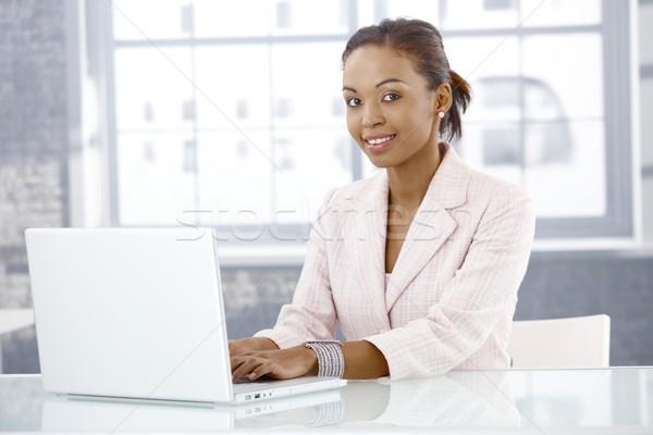 Afro businesswoman using laptop Stock photo © nyul