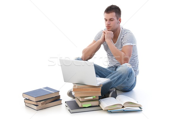 Young student using laptop studying Stock photo © nyul