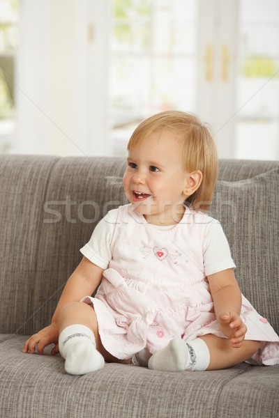 Happy babaygirl sitting on sofa Stock photo © nyul