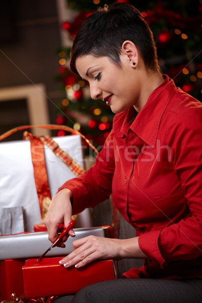 Young woman wrapping christmas gifts Stock photo © nyul