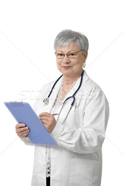 肖像 シニア 医師 クリップボード 見える カメラ ストックフォト © nyul