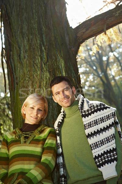 Portrait of young couple at tree Stock photo © nyul