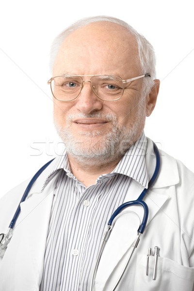 Stock photo: Portrait of senior doctor looking at camera