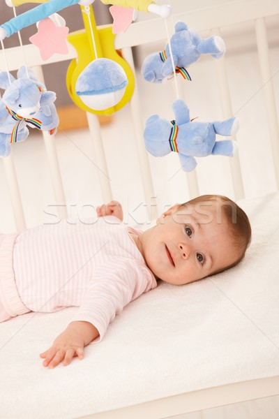 Stock photo: Portrait of baby girl in bed