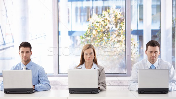 Young businesspeople with laptops Stock photo © nyul