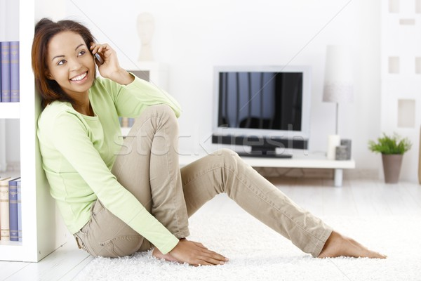 Cheerful woman calling in living room Stock photo © nyul