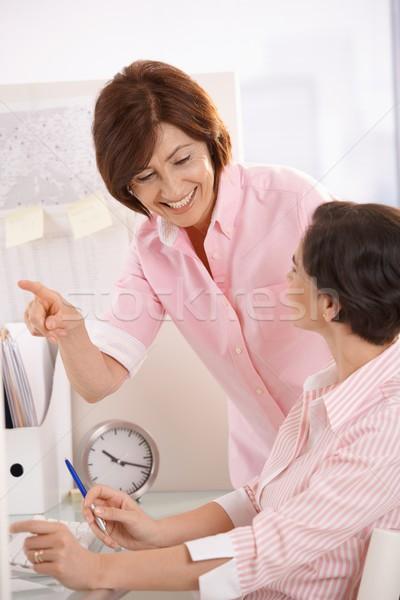 Senior office worker teaching coworker in office Stock photo © nyul
