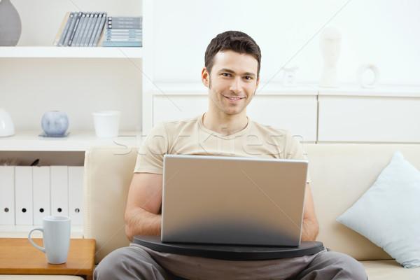 человека используя ноутбук домой счастливым случайный компьютер Сток-фото © nyul