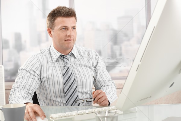Mid-adult businessman at work Stock photo © nyul