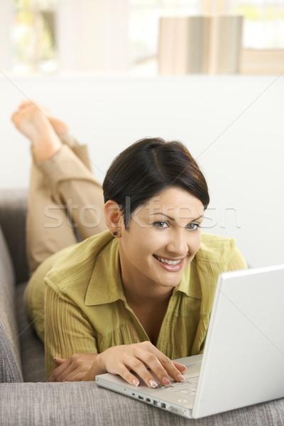 Happy woman browsing internet Stock photo © nyul
