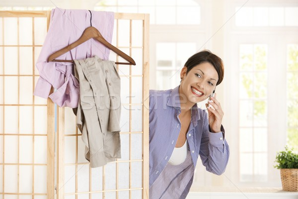 Young woman dressing in the morning Stock photo © nyul