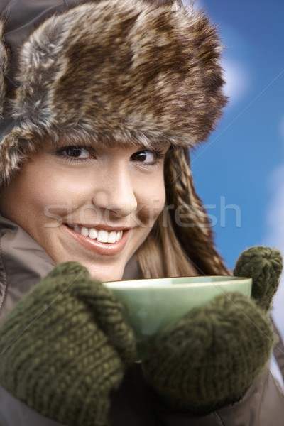 Pretty girl dressed up warm drinking tea smiling Stock photo © nyul