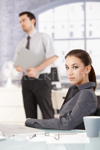 Portrait of young businesswoman sitting at desk Stock photo © nyul